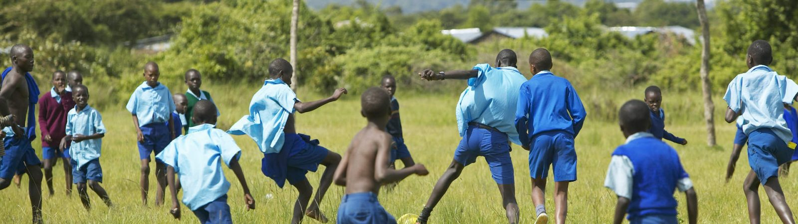 african-kids-playing-soccer